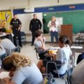 "St. Krouse, Ptl. Esposito and the Berea Prosecutor talk to students in preparation for reading project on ""To Kill A Mockingbird"""